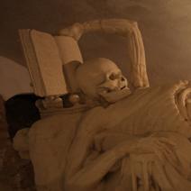 Zdj. nr 6;Symbole marności życia: ręka spoczywa na klepsydrze, druga na otwartej biblii - życie